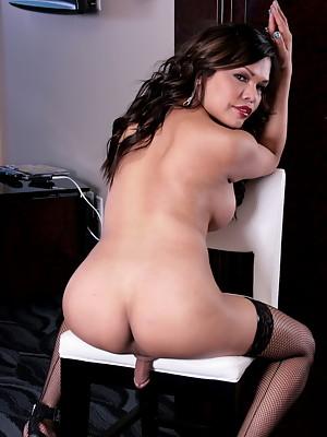Busty Carmen Moore posing in hot red lingerie